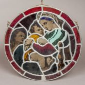 A lidded stained glass roundel depicting the Madonna and child,