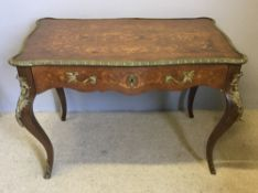 A 19th century marquetry inlaid and bronze mounted centre table The scrolling florally inlaid