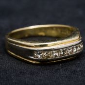 An 18 ct gold and diamond ring Set with a single band of diamonds totalling approximately 0.