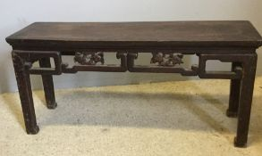 A 19th century Chinese hardwood low table Of alter table form,