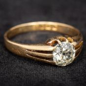 An 18 ct gold diamond solitaire ring The claw set stone spreading to approximately 1 carat.