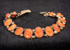 A small carved coral cameo bracelet 15 cm long.