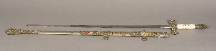 A 19th century Masonic sword With engraved ivory handle Knights helmet finial,