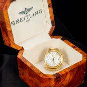 An 18 ct gold cased Breitling gentleman's wristwatch The white dial with three subsidiary dials and