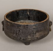 A large Chinese cast iron censer Of squat twin handled form,