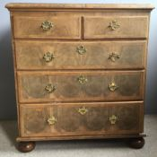 An 18th century walnut chest of drawers The moulded crossbanded top above an arrangement of two