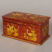 A 19th century chinoiserie lacquered tea caddy Decorated in gilt with various birds in a foliate