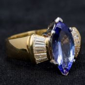 An 18 ct gold tanzanite and diamond ring The central claw set tanzanite flanked by twin rows