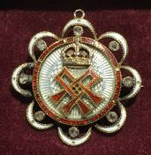 A Victorian unmarked gold, diamond and enamel pendant/brooch Of pierced lobed circular form,