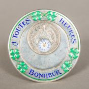 A Continental silver and enamel decorated desk clock Of circular form,