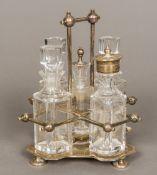 An Edwardian silver cruet stand, in the manner of Dr Christopher Dresser,