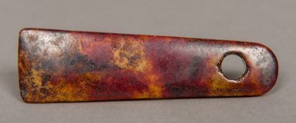 A Chinese carved russet jade pendant 10.5 cm long.