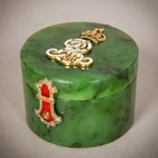 An enamel diamond, emerald and ruby set spinach jade box Of small cylindrical form,