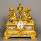 A 19th century French painted porcelain mounted ormolu mantel clock The white enamelled dial with