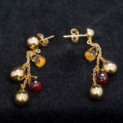 A pair of Thurlow and Champness 18 ct gold gem set earrings Each of multiple drop form, boxed.