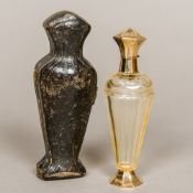 A 19th century French unmarked gold mounted cut glass scent bottle With engraved decorations,