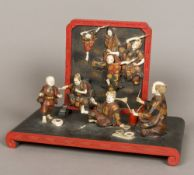 A fine quality Japanese Meiji period ivory and lacquer figural group Formed as a group of artists