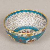A Chinese cloisonne bowl Typically worked with lotus strapwork. 11 cm diameter.