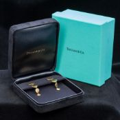 A pair of Tiffany & Co. 18 ct gold earrings Each of beaten circular drop form, boxed. Each 4.