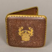A Japanese Komai type cigarette case Of arched hinged form, the front inset with a crest,