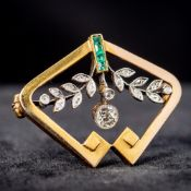 A Russian diamond and emerald set gold brooch Of pierced floral swag form. 3.2 cm wide.