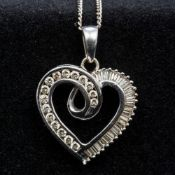An 18 ct white gold diamond set pendant and chain Formed as a heart. The pendant 2.5 cm high.