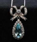 An 18 ct white gold diamond and aquamarine set pendant necklace Set as a bow tied drop.