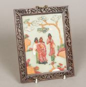 A late 19th/early 20th century Chinese jade and specimen hardstone panel Worked with figures