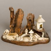 A 19th century Japanese bone, ivory and wooden landscape display Modelled with a figure on a bridge,