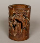 An 18th century Chinese pierced bamboo brush pot Carved in the round with various scholarly figures