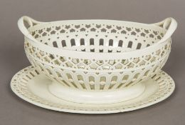 A late 18th/early 19th century Staffordshire creamware twin handled basket and stand,