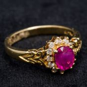 An 18 ct gold diamond and ruby cluster ring 9 cm high.