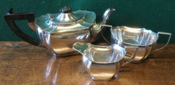 A George V silver three piece tea set, hallmarked Birmingham 1925 and 1926,