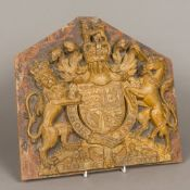 A 19th century carved wooden coat-of-arms of the British Royal Family Typically modelled,