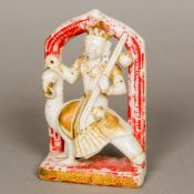 A 19th century Indian carved and polychrome decorated alabaster figure of a deity,