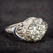 A diamond and sapphire set platinum ring The central claw set diamond spreading to approximately 2.