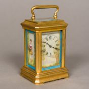 A brass cased miniature carriage clock Set with painted porcelain panels,