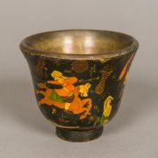 A 19th century Persian brass mounted papier mache cup Of flared tapering footed form,