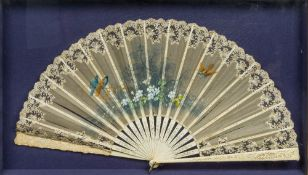 A late 19th century Continental decorated and lace worked bone fan The staves pierced and carved,