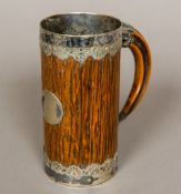A Victorian silver plate mounted carved wooden faux bamboo tankard,