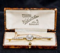 A Victorian 18 ct gold and platinum diamond and pearl bar brooch Centred with a pearl and diamond