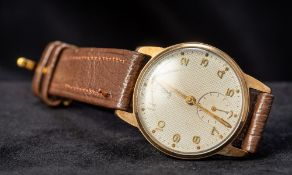 A 9 ct gold Tudor Rolex gentleman's wristwatch The dial with Arabic numerals and subsidiary sweep