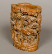 A 19th century Chinese bamboo brush pot Carved in the round with figures and pagodas in a tree