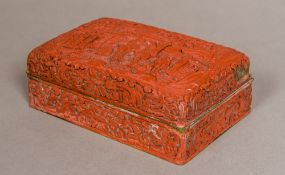 A 19th century Chinese cinnabar lacquered box and cover The domed removable lid decorated with