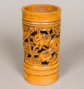 A Chinese pierced bamboo brush pot Of cylindrical form, carved with rabbits amongst foliage. 16.