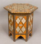 A North African inlaid coffee table The geometrically inlaid hinged hexagonal top enclosing the