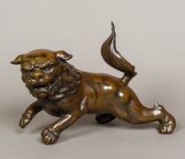 A patinated bronzed dog-of-fo Of large proportions, naturalistically modelled. 41 cm long.