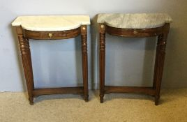A pair of Regency brass inlaid mahogany pier tables Each shaped marble top above the brass