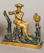 An 18th/19th century Continental carved giltwood and ebonised figure of a gentleman playing the