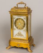 A 19th century French lacquered brass cased musical four glass mantel clock The brass dial with